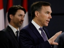 Canada's Minister of Finance Bill Morneau attends a news conference with Prime Minister Justin Trudeau in Ottawa March 11, 2020.