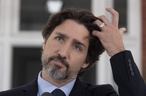 CP-Web.  Prime Minister Justin Trudeau adjusts his hair during a daily news conference outside Rideau Cottage in Ottawa, Friday May 22, 2020. THE CANADIAN PRESS/Adrian Wyld ORG XMIT: ajw101