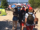 Screenshot of a video taken by @izabellagorski, shown on 6ixBuzzTV's Instagram account, of lots of people gathering at Wasaga Beach over the Canada Day holiday, despite Ontario still being in a state of emergency.