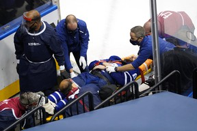 Leafs defenceman Jake Muzzin is carried off the ice on a stretcher during Tuesday's game.