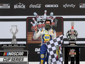 Chase Elliott, driver of the #9 NAPA Auto Parts Chevrolet, celebrates in Victory Lane after winning the NASCAR Cup Series Go Bowling 235 at Daytona International Speedway on August 16, 2020 in Daytona Beach, Florida.