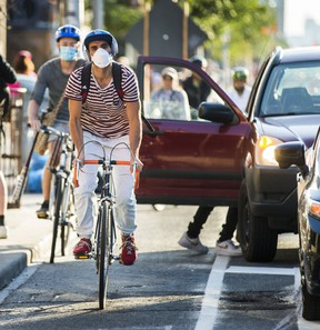 Cyclists on the eastbound bike lanes along Bloor St. W., near Ossington Ave., in Toronto, on Aug. 6, 2020.