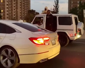 Toronto Rapper Top 5 stops traffic on Hwy. 401 Aug. 17, 2020 as part of a music video for a new track.