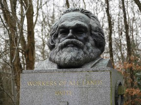 The bronze bust on top of the monument at the tomb of German revolutionary philosopher Karl Marx, a Grade I-listed monument, is seen in Highgate Cemetery in north London on February 5, 2019.