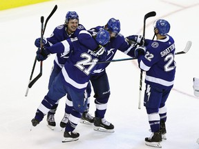 Brayden Point and the Tampa Bay Lightning celebrate his game-winning goal against the Columbus Blue Jackets at Scotiabank Arena on August 11, 2020 in Toronto.
