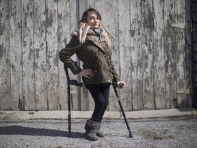 """A Toronto restaurant discriminated against a woman who uses mobility devices and """"publicly humiliated"""" her by refusing to let her use its bathroom four years ago, the Human Rights Tribunal of Ontario has ruled. Haily Butler-Henderson is photographed near her Toronto home , Friday, March 17, 2017."""