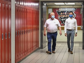 Ontario Premier Doug Ford, left, and Education Minister Stephen Lecce walk the hallway before making an announcement regarding the governments plan for a safe reopening of schools in the fall at Father Leo J Austin Catholic Secondary School in Whitby, Ont., on Thursday, July 30, 2020.