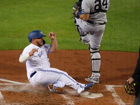 Alejandro Kirk of the Toronto Blue Jays slides safely to home plate during the third inning against the New York Yankees at Sahlen Field on September 21, 2020 in Buffalo, New York.