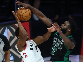 Celtics guard Jaylen Brown (right) fouls Raptors guard Kyle Lowry (left) during the second half of Game 2 of the second round of the 2020 NBA Playoffs at ESPN Wide World of Sports Complex, in Lake Buena Vista, Fla., Tuesday, Sept. 1, 2020.