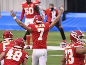 Kansas City Chiefs kicker Harrison Butker (7) celebrates with teammates after kicking the game-winning 58-yard field goal against the Los Angeles Chargers during overtime at SoFi Stadium on Sept. 20, 2020.