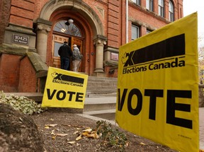 Voters are seen outside of a polling station during the Federal Election in Edmonton, Oct. 21, 2019.
