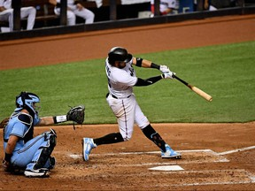 Marlins batter Miguel Rojas doubles in the 5th inning against the Blue Jays at Marlins Park, in Miami, Tuesday, Sept. 1, 2020.