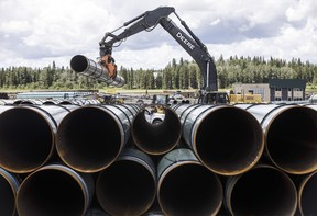 Pipe for the Trans Mountain pipeline is unloaded in Edson, Alta. on Tuesday June 18, 2019. THE CANADIAN PRESS/Jason Franson ORG XMIT: CPT112 ORG XMIT: POS2002101422466908 ORG XMIT: POS2003101433301574