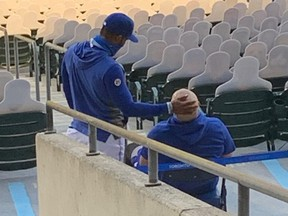 Injured Blue Jays players Teoscar Hernandez (left) and Rowdy Tellez monitor the action of their team's 7-2 loss to the New York Yankees on Sept. 9, 2020, from the stands at Sahlen Field in Buffalo.