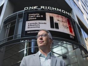 Bill Bewick, Executive Director, Fairness Alberta poses by an electronic billboard promoting the importance the Alberta's economy to Ontario, at the corner of Yonge and Richmond Sts in downtown Toronto, Ont. on Monday September 21, 2020. Ernest Doroszuk/Toronto Sun/Postmedia