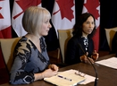 Minister of Health Patty Hajdu, left, listens as Chief Public Health Officer of Canada Dr. Theresa Tam participates in a press conference following the announcement by the Government of Ontario of the first presumptive confirmed case of a novel coronavirus in Canada, in Ottawa, on Sunday, Jan. 26, 2020.
