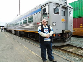 Daryl Adair of Winnipeg-based Rail Heritage Tours stands in front of the Budd car.
