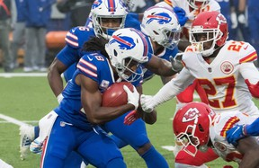 Buffalo Bills wide receiver Andre Roberts prepares to be tackled by Kansas City Chiefs' Byron Pringle (13) and cornerback Rashad Fenton on Monday night.