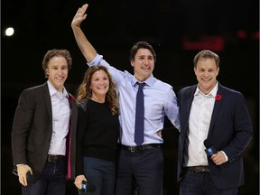 Prime Minister Justin Trudeau and his wife, Sophie, are flanked by We Day co-founders, Craig Kielburger, left, and his brother Marc, right, in front of a crowd of 16,000 people during the We Day event at the Canadian Tire Centre in Ottawa Tuesday Nov. 10, 2015.