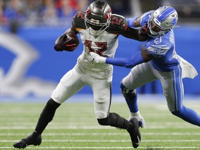 Dec 15, 2019; Detroit, MI, USA; Tampa Bay Buccaneers wide receiver Chris Godwin (12) stiff arms Detroit Lions defensive back Tracy Walker (21) during the second quarter at Ford Field. Mandatory Credit: Raj Mehta-USA TODAY Sports ORG XMIT: USATSI-403374