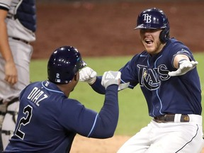 Tampa Bay's Michael Brosseau celebrates with Yandy Diaz after his solo home run against the New York Yankees during Game 5 of the American League Division Series on Friday night. The Rays take on the Houston Astros in the ALCS.Getty images