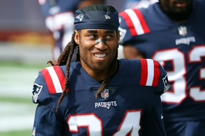 Stephon Gilmore of the New England Patriots looks on before a game against the Las Vegas Raiders at Gillette Stadium on Sept. 27, 2020 in Foxborough, Mass.