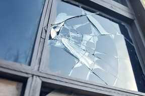 A broken glass window.