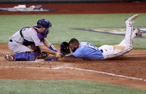 Manuel Margot  of the Tampa Bay Rays is tagged out by Austin Barnes of the Los Angeles Dodgers on an attempt to steal home during the fourth inning of Game 5 of the World Series on Monday night.