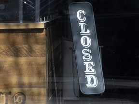In this file photo, a sign is posted in a Toronto business that was temporarily closed due to the coronavirus pandemic.