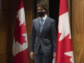 Prime Minister Justin Trudeau arrives for a news conference Tuesday Oct. 20, 2020 in Ottawa.