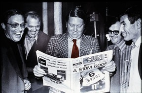 Former publisher Doug Creighton, left, holds the first copy of The Toronto Sun on Nov. 1, 1971, with Ray Biggart (centre) and Peter Worthington (right) and general manager Don Hunt (left).
