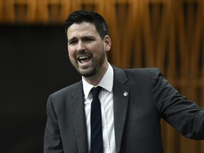 Parliamentary Secretary to the Minister of Finance and to the Minister of Middle Class Prosperity Sean Fraser rises during Question Period in the House of Commons on Parliament Hill in Ottawa, Feb. 28, 2020.