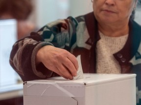 A person votes a polling station at Alderwood Pool for Canada's 43rd general election Oct. 21, 2019 in Etobicoke, Ont.