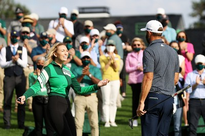 Dustin Johnson of the United States celebrates with fiancée Paulina Gretzky after winning the Masters at Augusta National Golf Club on November 15, 2020 in Augusta, Georgia.