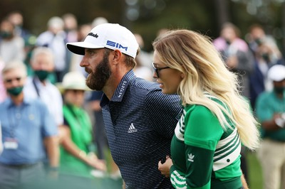 Dustin Johnson of the United States walks with fiancée Paulina Gretzky after winning the Masters at Augusta National Golf Club on November 15, 2020 in Augusta, Georgia.
