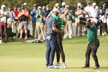 Dustin Johnson of the United States kisses fiancée Paulina Gretzky after winning the Masters at Augusta National Golf Club on November 15, 2020 in Augusta, Georgia.