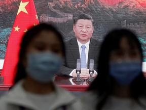 China's President Xi Jinping is seen on a screen in a media centre as he speaks at the opening ceremony of the third China International Import Expo (CIIE) in Shanghai, China on Nov. 4, 2020.