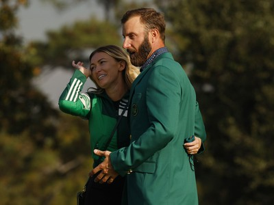 Dustin Johnson of the U.S. celebrates with his green jacket and partner Paulina Gretzky after winning The Masters.