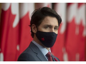 Prime Minister Justin Trudeau listens to a Minister speak via video conference during a news conference in Ottawa, Tuesday November 10, 2020.