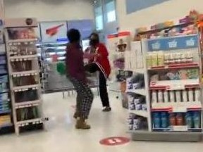 A woman nearly strikes and kicks a Shoppers Drug Mart employee in Scarborough in a video posted online.