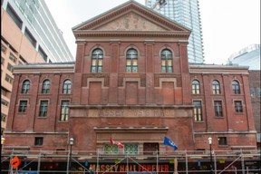 The facade of Massey Hall now reads Massey Music Hall after some stone work and the removal of fire escapes.