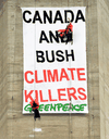 Greenpeace activists Steven Guilbeault, left, and Chris Holden hang from cables near the the top of Toronto's CN Tower, July 16, 2001.