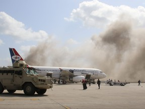 A military vehicle is seen on the tarmac during an attack on Aden airport moments after a plane landed carrying a newly formed cabinet for government-held parts of Yemen, in Aden, Yemen Dec. 30, 2020.