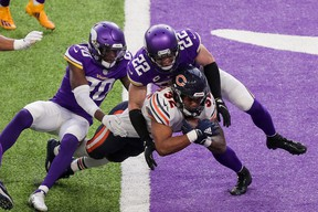 Chicago Bears running back David Montgomery dives for a TD against Minnesota.