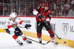 Oliver Ekman-Larsson  of the Arizona Coyotes clears the puck away from Aleksander Barkov  of the Florida Panthers during the first period of the NHL game at Gila River Arena on February 25, 2020 in Glendale, Arizona.  According to Forbes magazine, the value of each team has dropped 5% since the COVID-19 pandemic took hold last March.