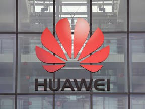 The Huawei logo is pictured on the headquarters building in Reading, Britain July 14, 2020