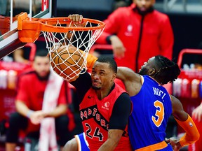 Norman Powell of the Toronto Raptors dunks the ball against Nerlens Noel of the New York Knicks at Amalie Arena on December 31, 2020 in Tampa.