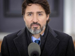 In this file photo taken on Nov. 20, 2020, Prime Minister Justin Trudeau speaks during a COVID-19 pandemic briefing from Rideau Cottage in Ottawa.
