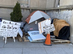 A homeless man known as Graffiti Guy, who was turfed from the COVID emergency shelter at the Roehampton Hotel in midtown Toronto, has set up camp on Yonge St. just north of Eglinton Ave.