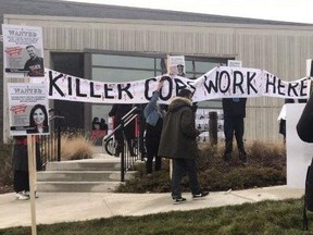 Anti-police protesters demonstrated outside Peel Regional Police Service's 11 Division in Mississauga on Friday, Dec. 11, 2020. The police station was also splattered with red paint.